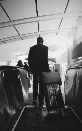 man-on-business-travel-at-airport-NAZZNRX